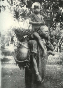 Woman coming from the river. The Construction of the harness for the water pot, ndigithu is an architectural masterpiece